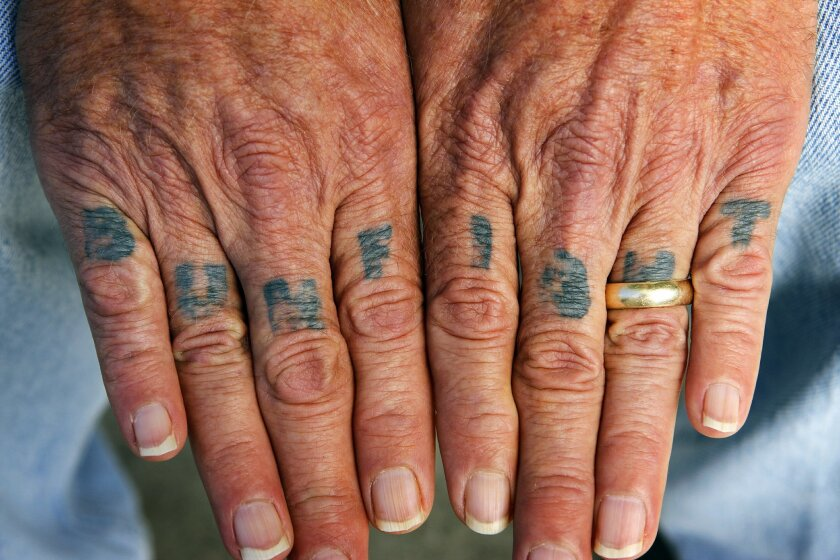 Laser treatment has faded the once-famous tattooed letters on Rufus Hannah's fingers, but they are still a reminder of a life he hopes he's left behind.