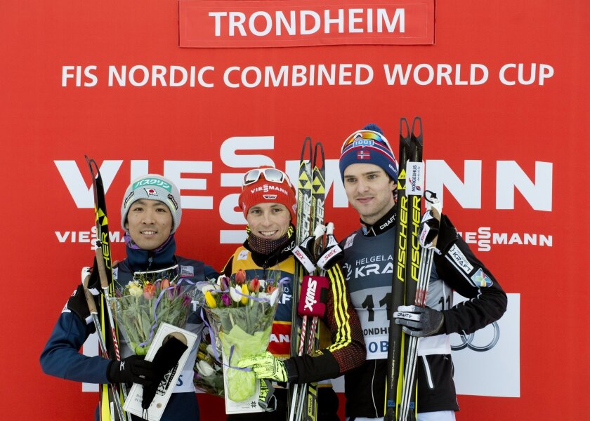 Winner Eric Frenzel from Germany, center, celebrates with second placed Akito Watabe from Japan, left, and third placed Joergen Graabak from Norway on the podium after the FIS World Cup Nordic Combined competition in Trondheim, Norway, Wednesday Feb. 10, 2016. (Ned Alley/NTB Scanpix via AP) NORWAY