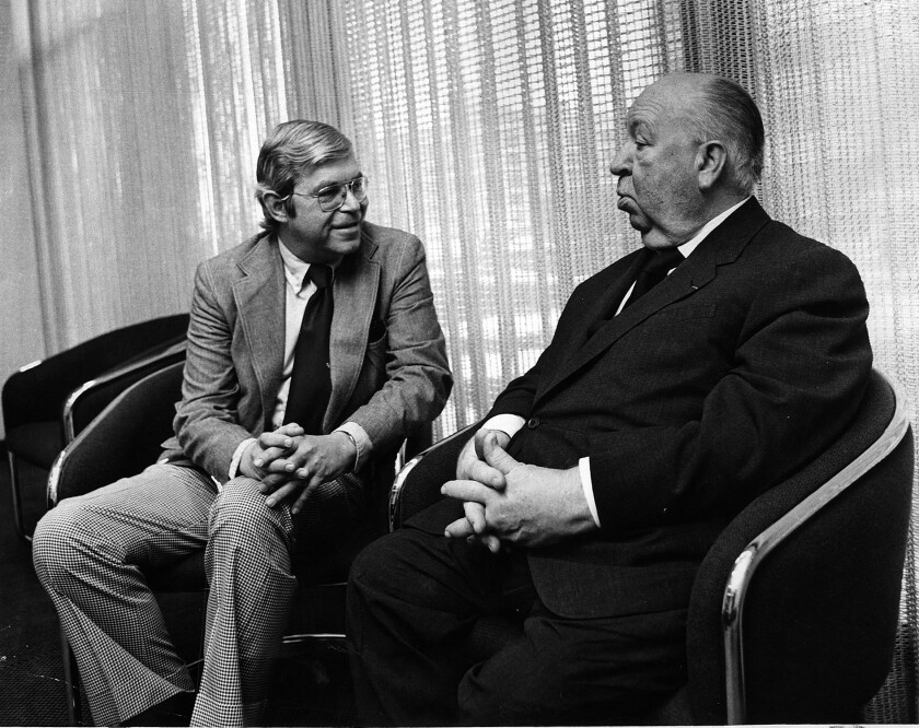 Former Los Angeles Times film critic Charles Champlin speaks with director Alfred Hitchcock in 1977. Champlin was The Times' principal film critic from 1967 through 1980.