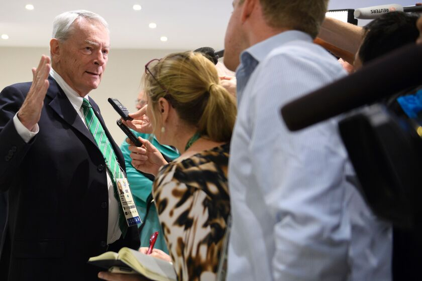 Dick Pound, an International Olympic Committee member from Canada, addresses the media in Rio de Janeiro before the start of the 2016 Summer Games, which were threatened by the Zika virus.
