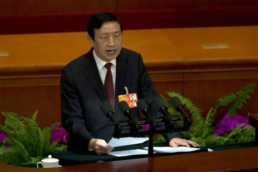 Ma Kai, secretary-general of the State Council, speaks during a plenary session of the National People's Congress held at the Great Hall of the People in Beijing, China, Sunday, March 10, 2013.  Ma read out the report on the Cabinet's plan to streamline government ministries, doing away with the po