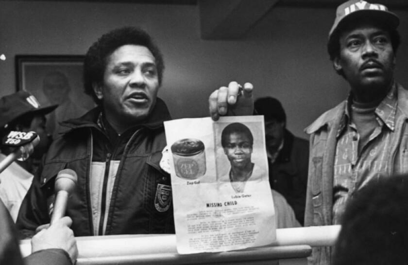 Eldrin Bell showing a photo of the missing Lubie Geter at a press conference in 1981.