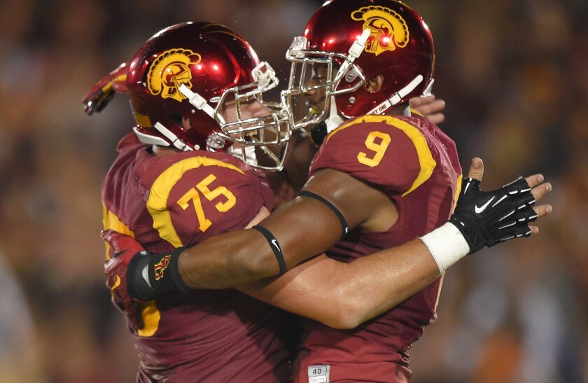 Southern California wide receiver JuJu Smith, right, celebrates his touchdown with center Max Tuerk during the first half of an NCAA college football game against California, Thursday, Nov. 13, 2014, in Los Angeles. (AP Photo/Mark J. Terrill)