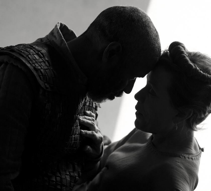 """This image released by Apple shows Denzel Washington, left, and Frances McDormand in a scene from """"The Tragedy of Macbeth,"""" premiering at the New York Film Festival. (Alison Rosa/Apple via AP)"""