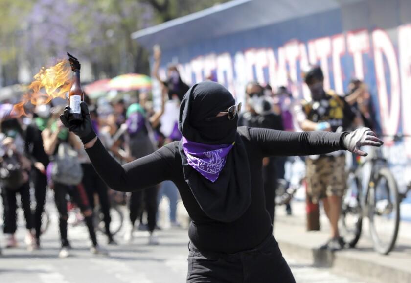 A woman throws a petrol bomb