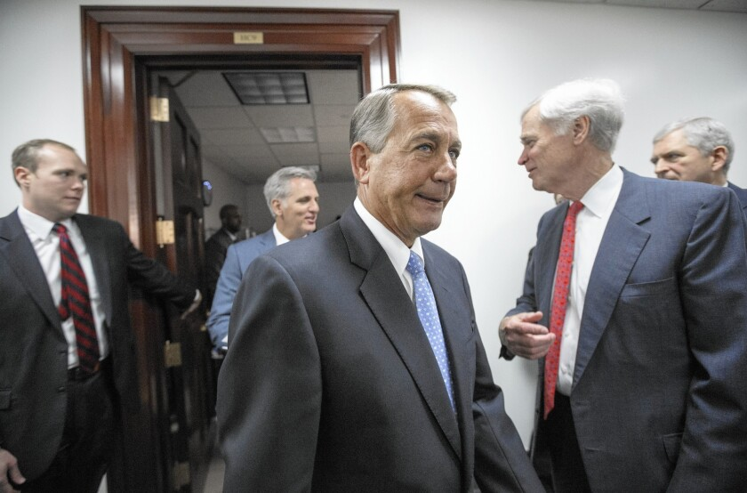 House Speaker John Boehner, center, hopes his proposal will prevent his party's opponents of President Obama's immigration policy from forcing a government shutdown.