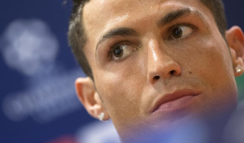 Real Madrid's Cristiano Ronaldo looks on during a press conference at the Olympic Stadium in Rome, Italy, Tuesday, Feb. 16, 2016. Real Madrid faces Roma in a UEFA Champions League soccer match Wednesday. (Claudio Peri/ANSA via AP Photo) ITALY OUT