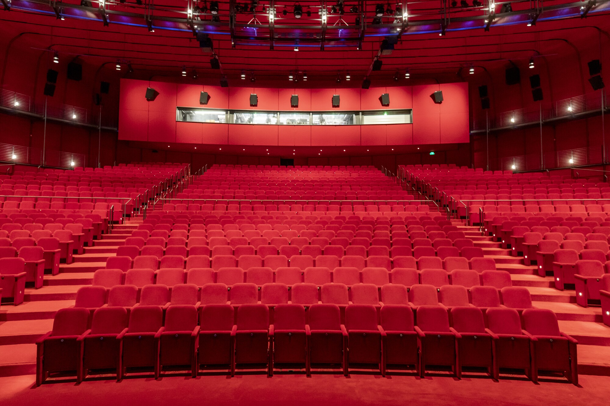 The David Geffen Theater at the new Academy Museum of Motion Pictures is a sea of red — red seats, red floor, red walls.