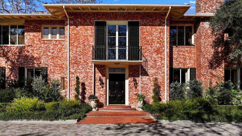 The brick Monterey Colonial, designed by Roland Coate and built in 1941, has twice been honored as a