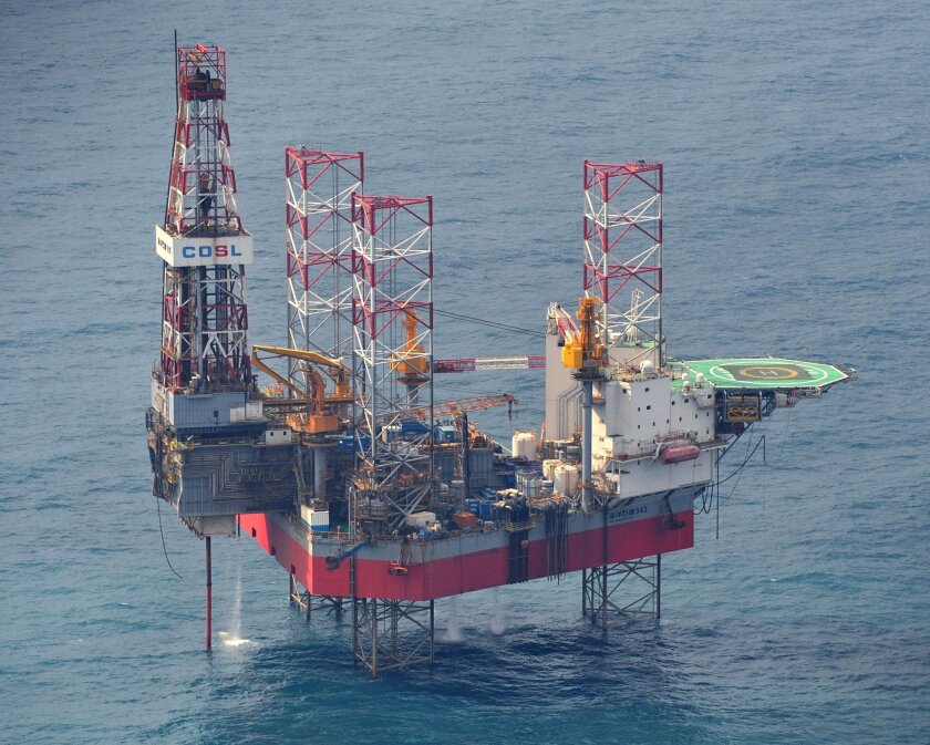 This Feb. 9, 2012 photo shows a China's oil rig operated in the East China Sea. Two state-owned companies, China General Nuclear Power Group and China National Nuclear Corp., have announced plans to develop floating nuclear reactors for use by oil rigs or island communities. If they succeed, the ac