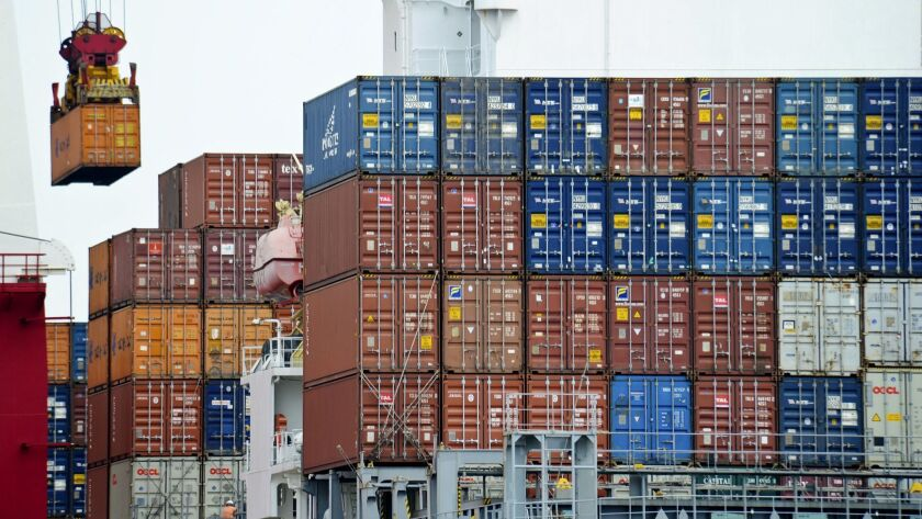 A container is loaded onto a cargo ship at the Tianjin port in China in August 2010.