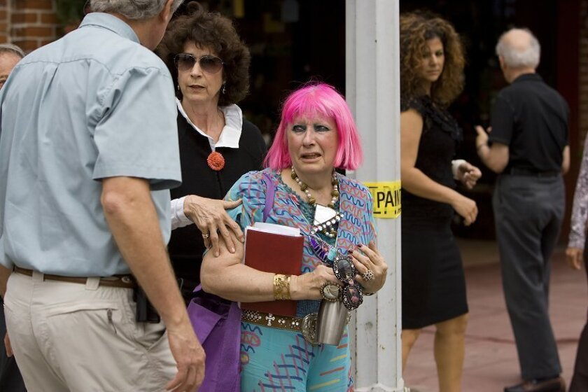 Zandra Rhodes the driver of a Ford Taurus wagon looks a little in shock after she accidentally drove her car through the window of Ace Hardware (Meanley & Son Hardware) on Girard Avenue in La Jolla.