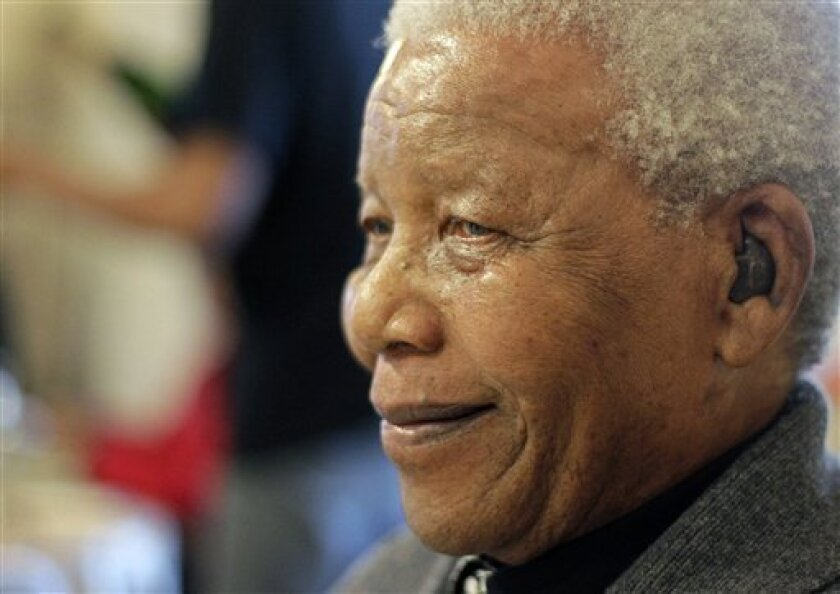 FILE- Former South African President Nelson Mandela as he celebrates his 94th birthday in Qunu, South Africa, in this file photo dated Wednesday, July 18, 2012. Mandela is still being treated in hospital for a recurring lung infection, Saturday Aug. 31, 2013. (AP Photo/Schalk van Zuydam, FILE)