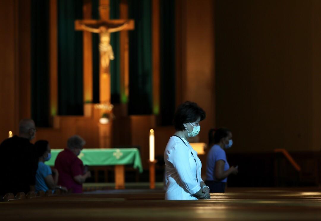 Parishioners attend mass at San Gabriel Mission Church in San Gabriel.