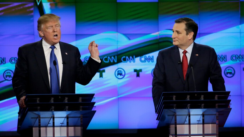 Joining together to foment a myth about the Internet: Donald Trump and his new endorser, Ted Cruz, seen here during a GOP campaign debate in February.