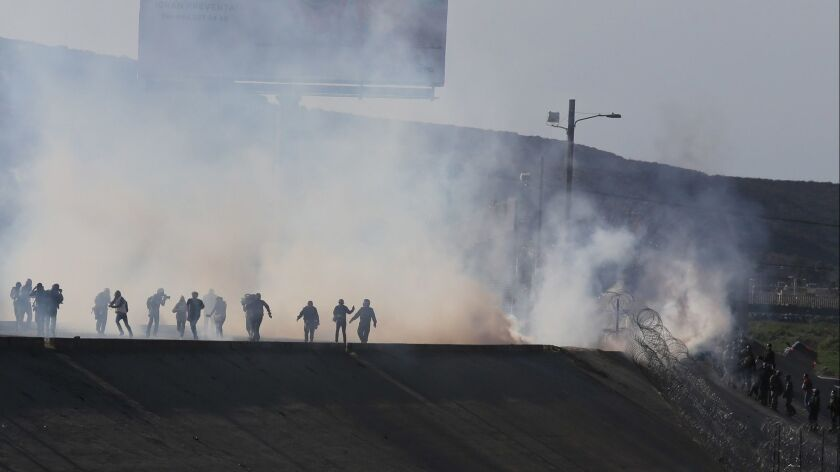 Border police fire tear gas to prevent groups of people from crossing the U.S.-Mexico border on Nov. 25.