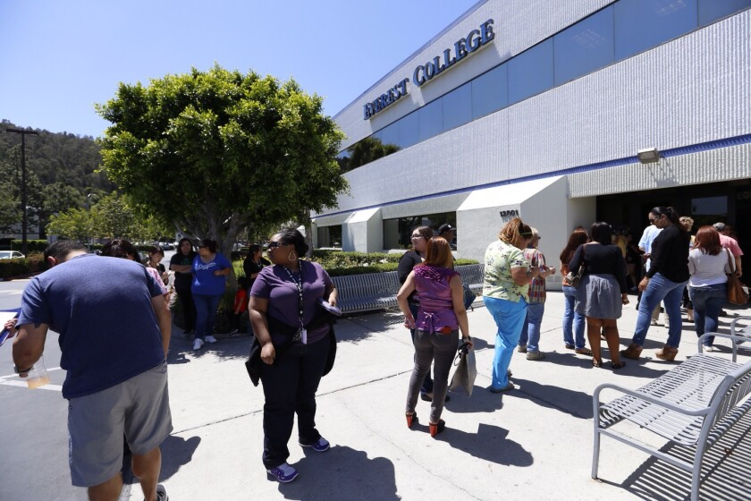 Teachers line up to collect their personal items after Everest College in the City of Industry -- one of more than two dozen campuses owned by the Corinthian Colleges system -- closed suddenly in April 2015.