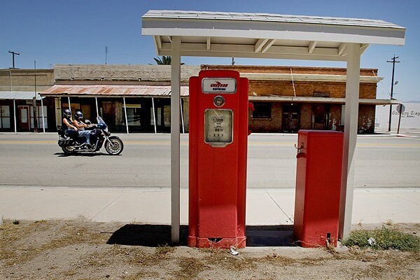 An old gasoline pump and a wooden Pacific pumping unit used during World War II sit in a park on California Street in Maricopa, a Kern County oil town in such financial straits that the county's grand jury is suggesting that it give up the cityhood it established 100 years ago this month. See full story