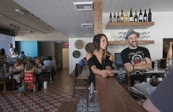 Waitress Lizzy Ziogas and co-owner Ryland Engelhart greet costumers at a new vegan restaurant, Cafe Gratitude, on North Larchmont Boulevard in Los Angeles. The specialty of the house is a spirit of community and gratitude.