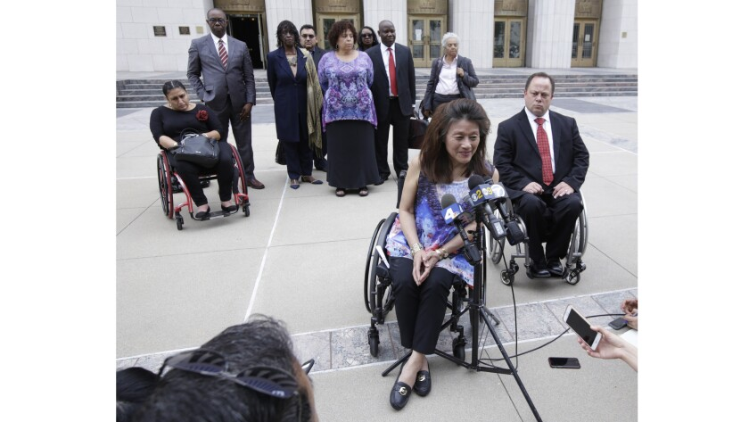 Mei Ling speaks outside the federal courthouse in Los Angeles. The U.S. is joining a whistle-blower lawsuit filed by Ling and a housing nonprofit that alleges L.A. improperly received federal funds by falsely claiming it was following laws that require accessible housing.