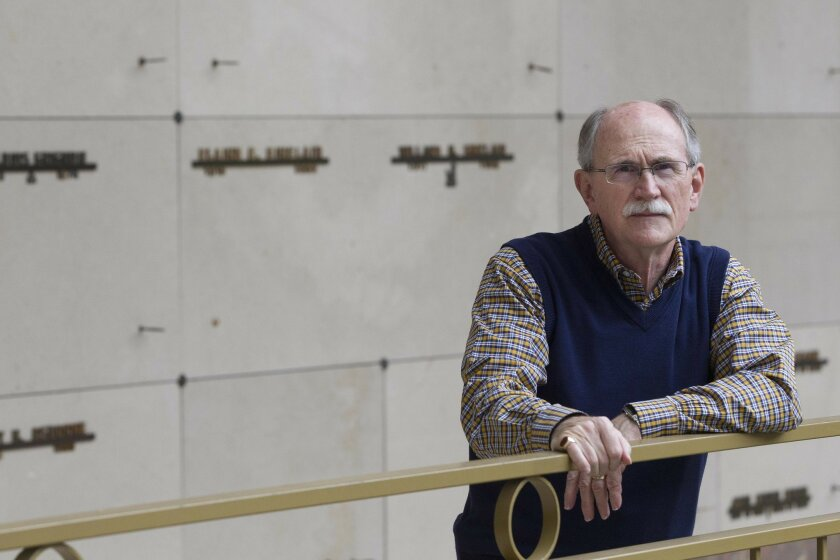 Retired Navy Capt. Bill Heard's research helped uncover the story of a forgotten Medal of Honor recipient from the Indian Wars who was in an unmarked, communal crypt at San Diego's Greenwood Cemetery. The ashes were kept in a crypt like the ones behind Heard.