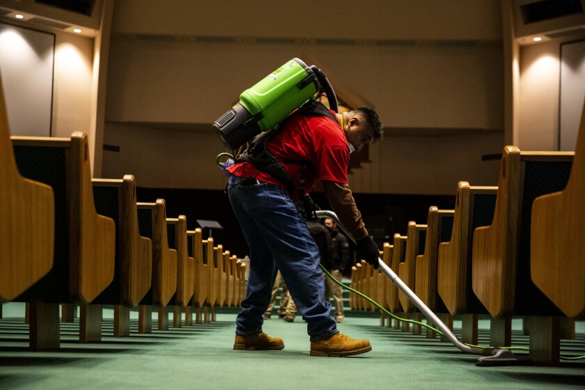 PARADISE, CALIF. - DECEMBER 14: Servpro cleaner Johnny Velasquez of Yuba City vacuums between pews a