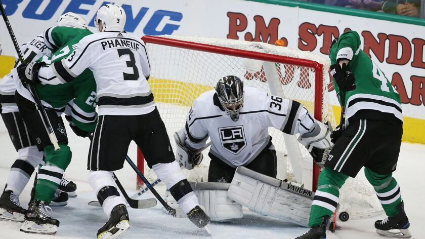 Kings goaltender Jack Campbell (36) turns away the Dallas Stars' Roman Polak (45) in the second period at the American Airlines Center in Dallas on Thursday.