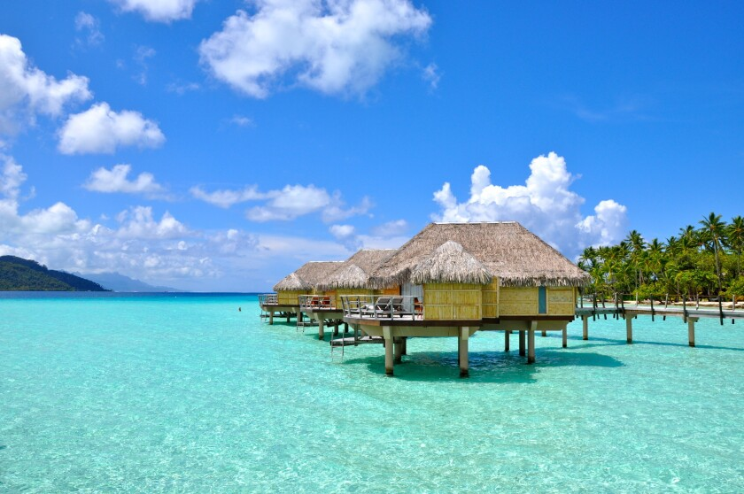 Over-water bungalows at Le Taha'a Island Resort and Spa in Tahiti
