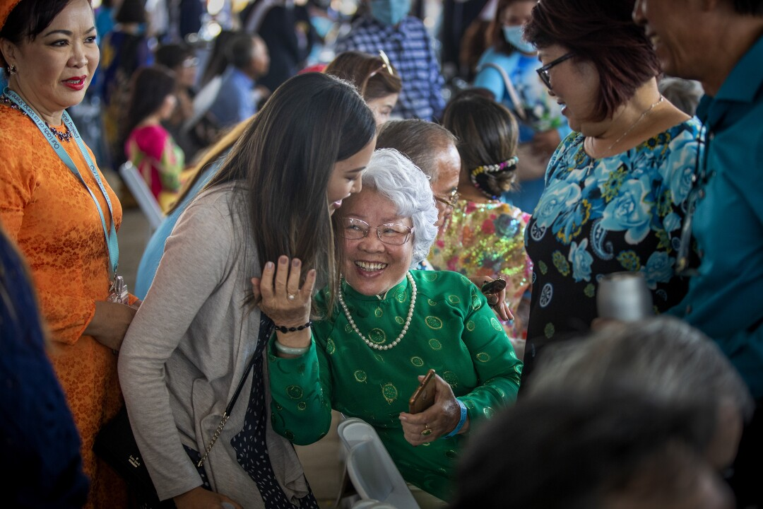 Vietnamese-Americans embrace in celebration of Our Lady of La Vang Solemn Blessing Day.