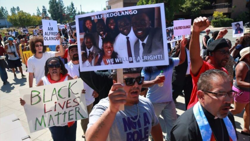 Protestors, faith leaders and family members of Alfred Olango marched around the El Cajon Civic Center.
