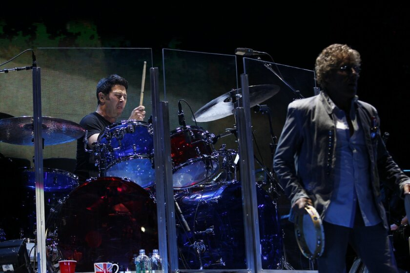 "The Who, on its 2013 North American concert tour, ran through its entire ""Quadrophenia"" double-album at Valley View Casino Center Tuesday night. Above, lead singer Roger Daltrey (right) and drummer Scott Devours, who made his debut with the legendary band here after only two hours of rehearsal."