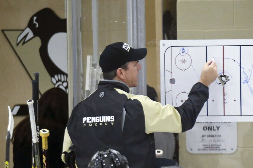 Pittsburgh Penguins head coach Mike Sullivan diagrams a play during NHL hockey practice at the UPMC Lemieux Sports Complex, Saturday, May 28, 2016, in Cranberry, Pa. The Penguins host the San Jose Sharks in Game 1 of the Stanley Cup Finals on Monday, May 30. Mike Sullivan wasn't Rutherford's first