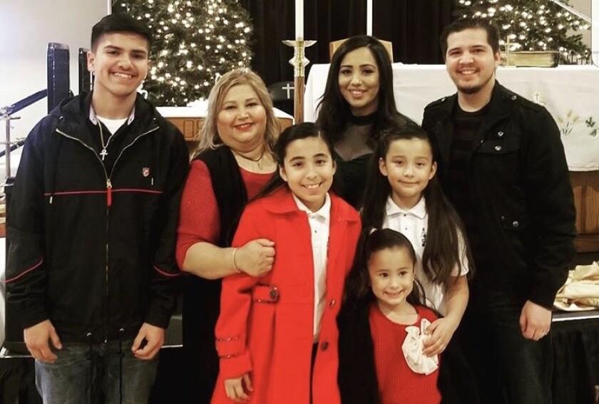 Susie Garcia, 52, with her three children and three of her grandchildren