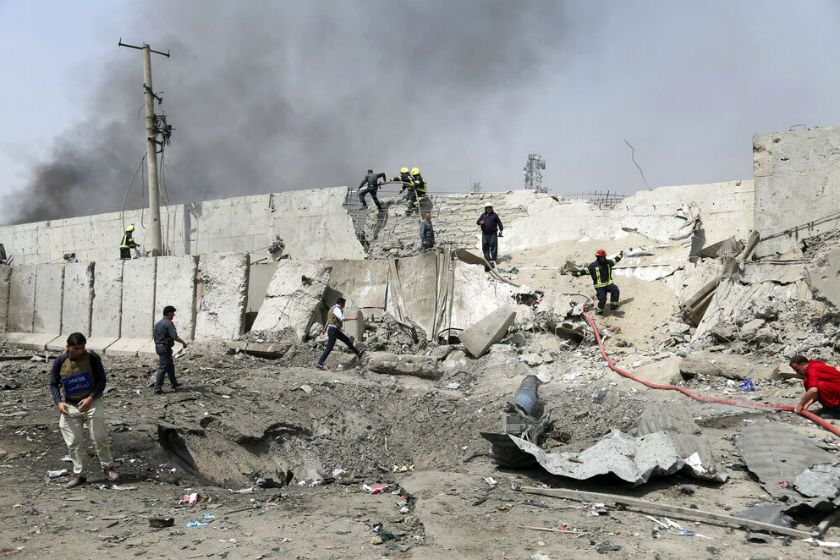 Afghan firefighters work at the site of a suicide bomb attack in Kabul.