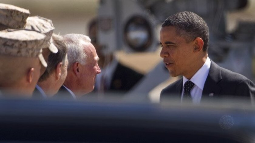 President Barack Obama is greeted by San Diego Mayor Jerry Sanders after landing at MCAS Miramar for a fundraiser in La Jolla