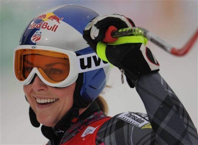Lindsey Vonn, of the United States, celebrates at finish line after winning an alpine ski, women's World Cup downhill race, in Haus im Ennstal , Austria, Saturday, Jan. 9, 2010. (AP Photo/Giovanni Auletta)