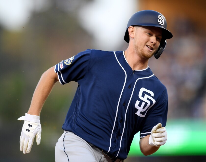 The Padres' Eric Lauer comes around third on his way to score off of a Eric Hosmer to take a 1-0 lead over the Los Angeles Dodgers, during the third inning at Dodger Stadium on July 05, 2019 in Los Angeles, California.