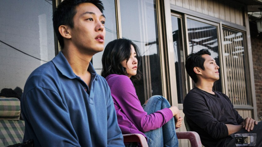 """(L-R) - You Ah-In, Jeon Jong-seo and Steven Yeun in a scene from """"BURNING."""" Credit: WellGo USA"""