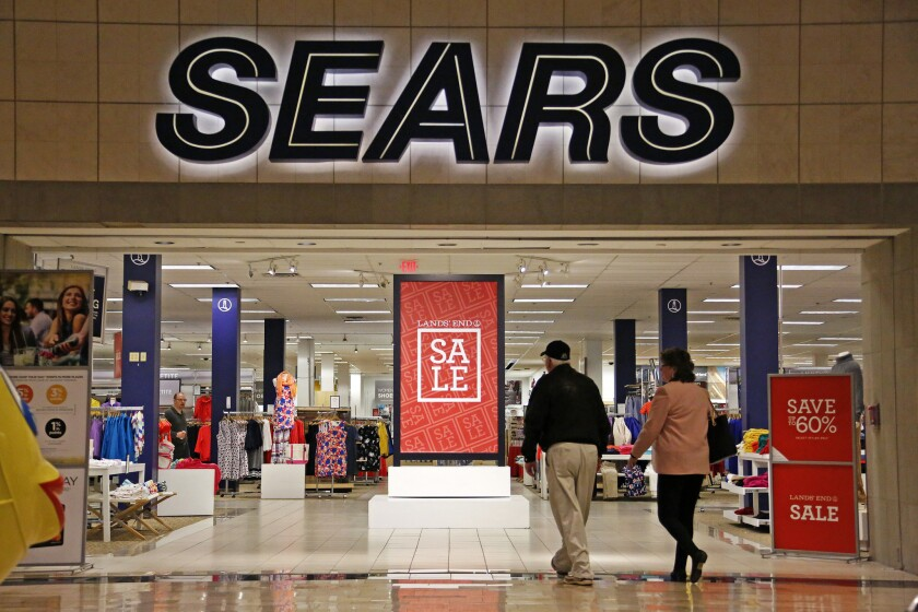 Shoppers walk into a Sears store in Pittsburgh in February.