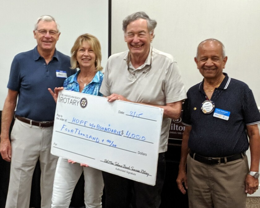 Del Mar-Solana Beach Rotary presented Hope Without Boundaries with $4,000 for improvements to the Campamento de Fe home for men in Tijuana who are injured or dying and have no family or resources. L to R: Paul Sagar, Hope Without Boundaries CFO, Lesley Sagar, Hope Without Boundaries president, Herb Liberman, DMSB Rotary International Service chair, and Venky Venkatesh, DMSB Rotary president.