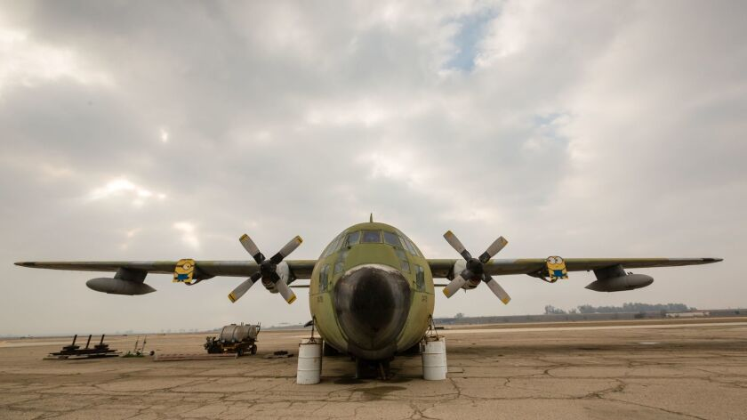 A C-130 rusts away on the tarmac at the Visalia airport. Commercial airlines service has been cut t