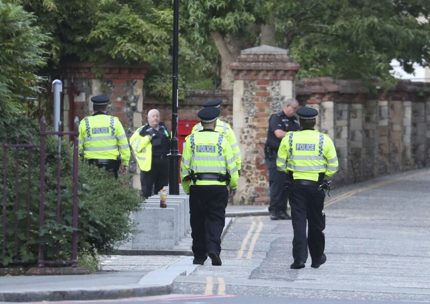 Police arrive at Forbury Gardens in the town center of Reading, England