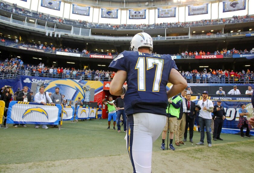 Chargers quarterback Philip Rivers runs off the field after a 17-3 loss to the Denver Broncos.