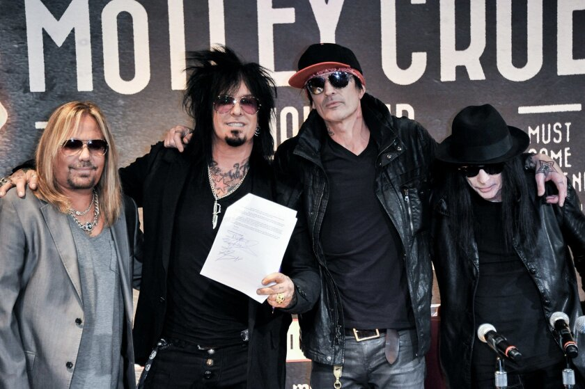 Vince Neil, Nikki Sixx, Tommy Lee, and Mick Mars of Motley Crue on Jan. 28, 2014, in Los Angeles.