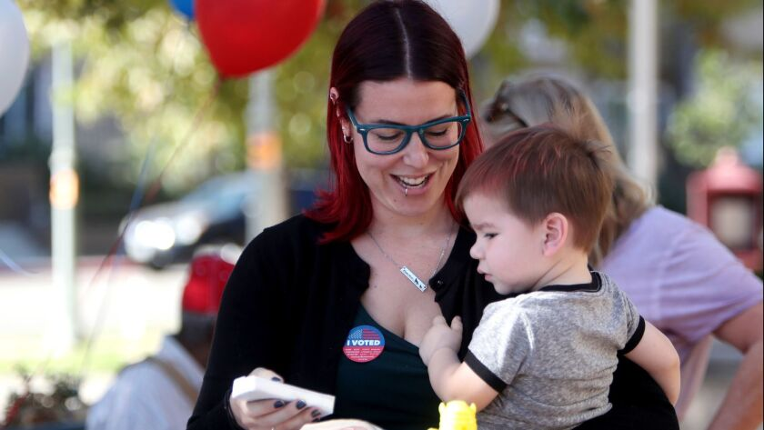 Jessica Collette of Burbank grabbed an ice cream for her 20-month old son Kingston Collette outside