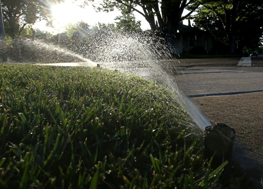 A lawn in Sacramento, Calif. is irrigated on May 27. California's drought-stricken cities set a record for water conservation, reducing usage 29 percent in May, according to data released by a state agency Wednesday, July 1.