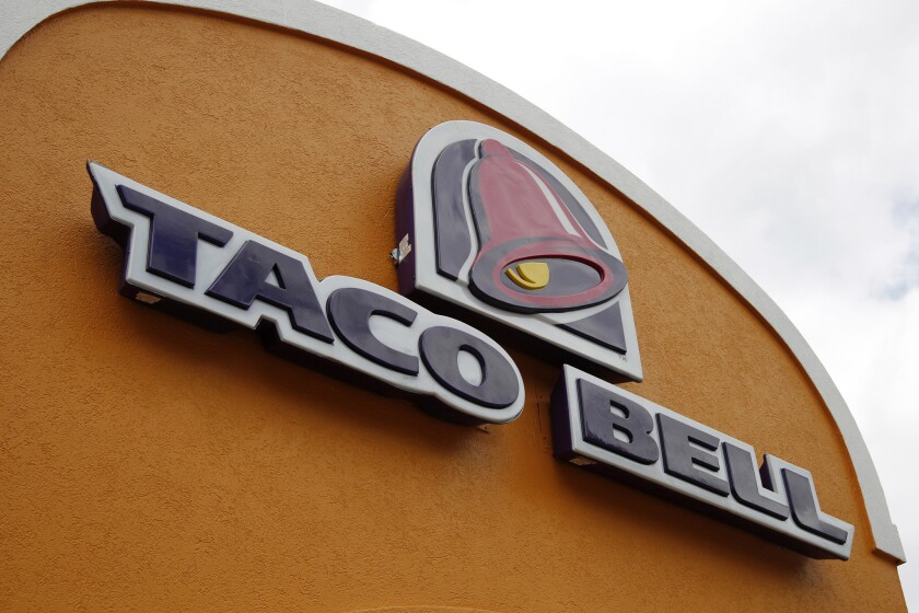 Taco Bell said it will test a $100,000 salary for restaurant managers at select locations in the Midwest and Northeast.