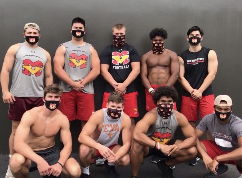Mission Viejo football players wear their customized Mission Viejo masks.