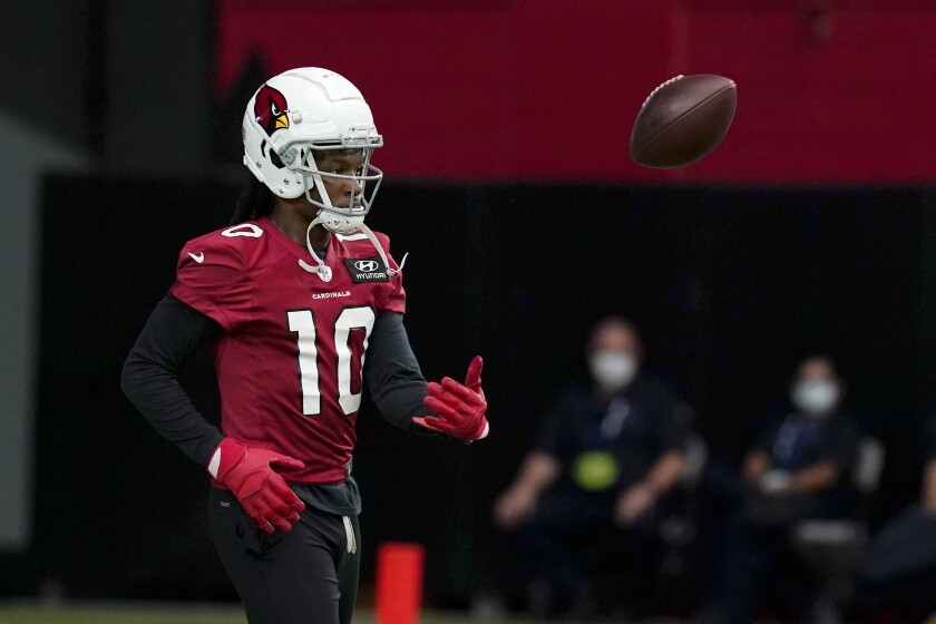 Cardinals receiver DeAndre Hopkins flips the football away after making a catch.