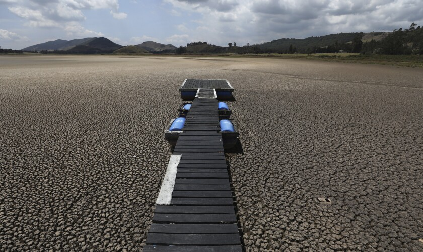 Floating dock atop dried-up lakebed in Colombia